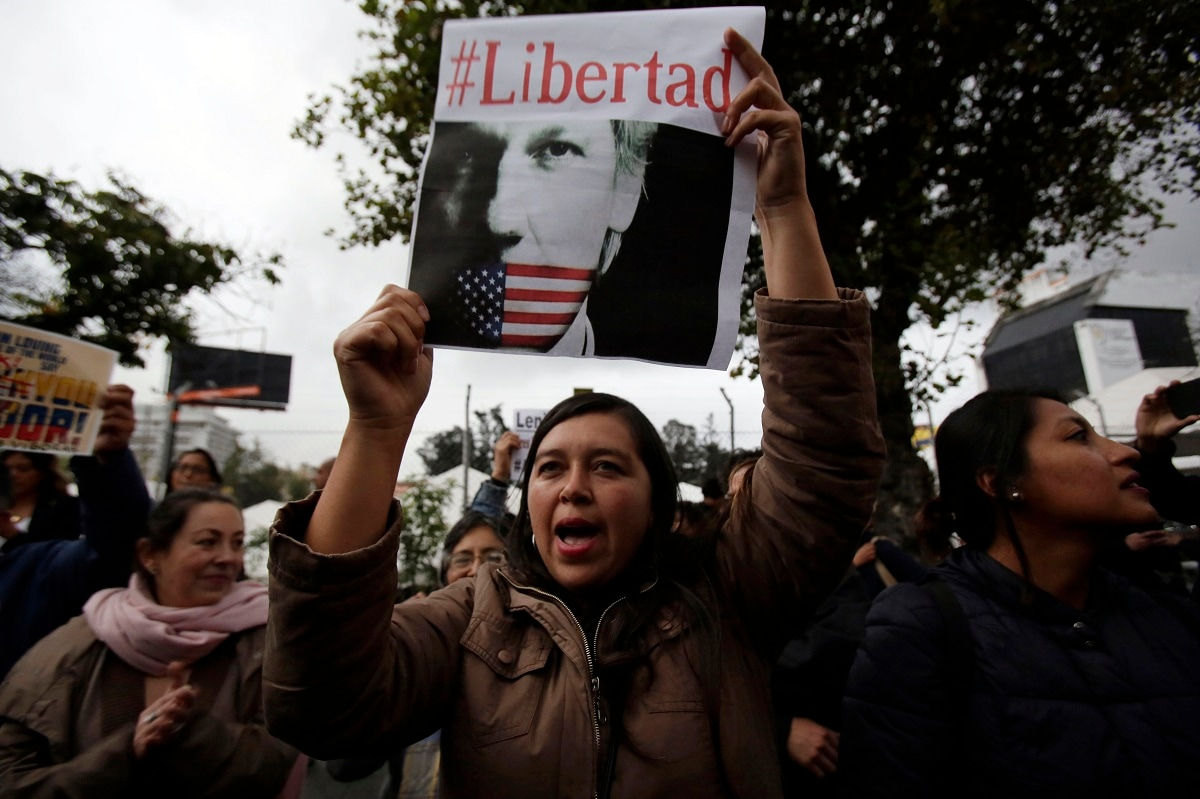 A woman holds up the Spanish hashtag #Freedom during a protest against the arrest of WikiLeaks founder Julian Assange, outside the Foreign Ministry in Quito, Ecuador. On Thursday, Ecuador's President Lenin Moreno allowed British authorities to forcibly remove Assange from Ecuador's small embassy in London where he was given safe haven in 2012. (AP Photo/Dolores Ochoa)
