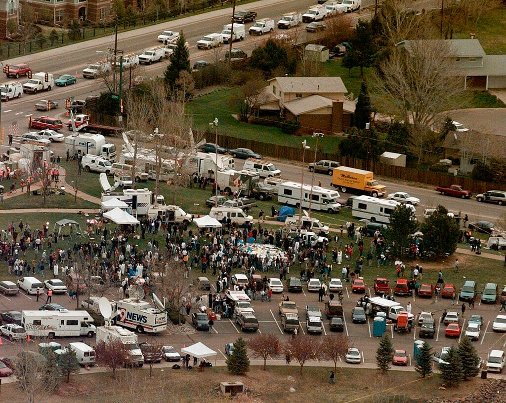 This April 21, 1999, file photo, shows the news media compound near Columbine High School in Littleton, Colo. (AP Photo/Ed Andrieski, File)