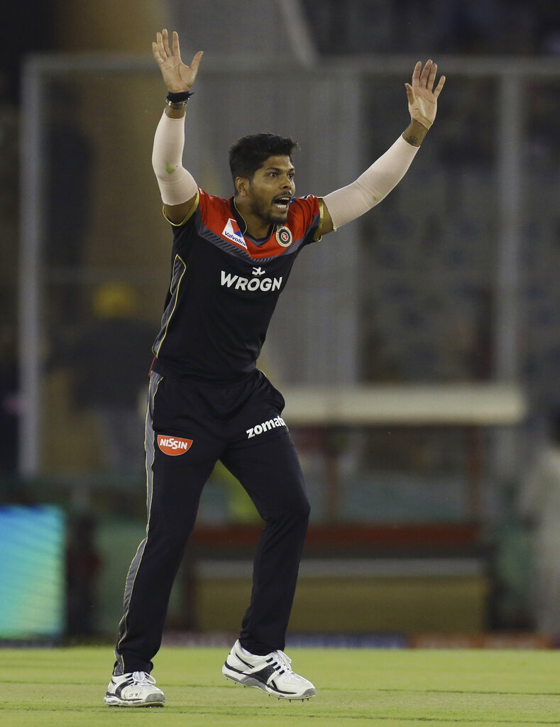 Umesh Yadav of Royal Challengers Bangalore raises his hands during the VIVO IPL T20 cricket match between Kings XI Punjab and Royal Challengers Bangalore in Mohali, India, Saturday, April 13, 2019. (AP Photo/Surjeet Yadav)