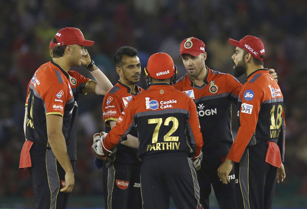 Yuzvendra Chahal of Royal Challengers Bangalore, second left, celebrates the wicket of KL Rahul of Kings XI Punjab during the VIVO IPL T20 cricket match between Kings XI Punjab and Royal Challengers Bangalore in Mohali, India, Saturday, April 13, 2019. (AP Photo/Surjeet Yadav)
