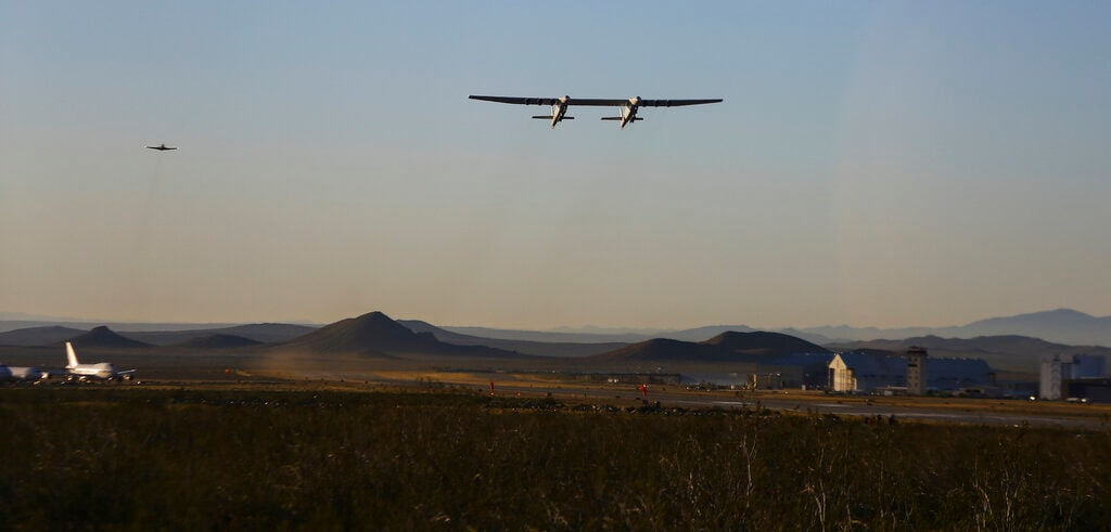 Stratolaunch, a giant six-engine aircraft with the world's longest wingspan, makes its historic first flight from the Mojave Air and Space Port in Mojave, Calif., Saturday, April 13, 2019. (AP Photo/Matt Hartman)