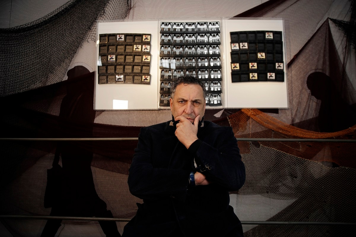 Italian photographer Maurizio Galimberti, poses next to his creation made with Polaroid unused cartridges, at the National Museum of Science and Technology, during the