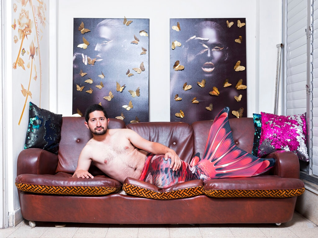 In this Thursday, Feb. 28, 2019 photo, Gal Amnony, a member of the Israeli Mermaid Community, poses for a portrait at his home in Ramat Gan, Israel. (AP Photo/Oded Balilty)