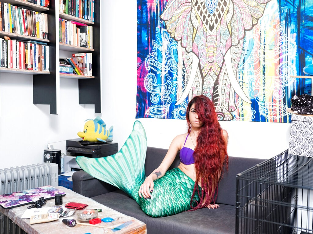 In this Sunday, Feb. 24, 2019 photo, May Lighty Cohen, a member of the Israeli Mermaid Community, poses for a portrait at her home in Herzliya, Israel. (AP Photo/Oded Balilty)