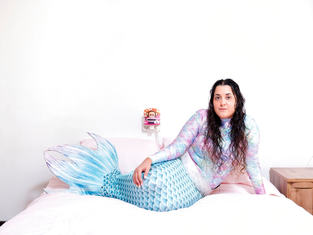 In this Monday, Feb. 18, 2019, photo, Chen Amsalem, a member of the Israeli Mermaid Community, poses for a portrait at her home in Bat Yam, Israel. (AP Photo/Oded Balilty)