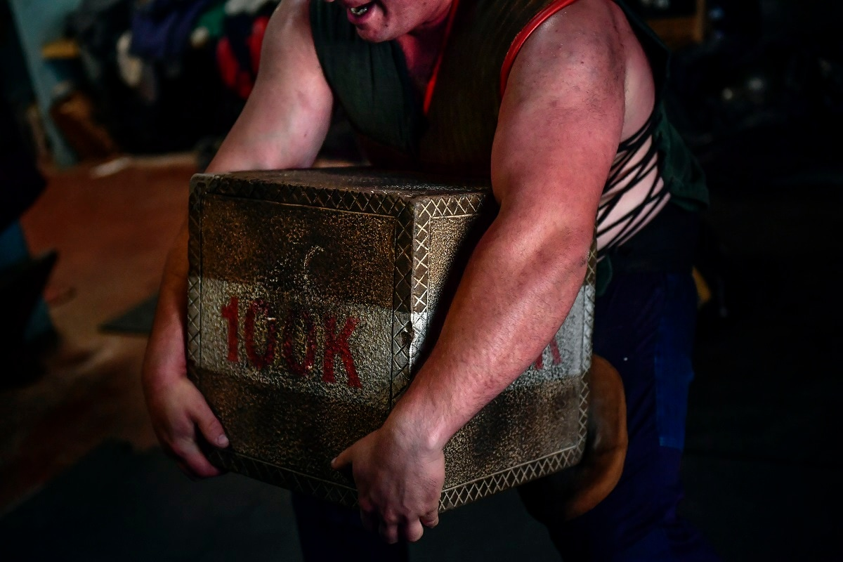 Inigo Eizagirre, 24, a basque stone lifter, holds a 100 kilograms stone during a training session in the Basque village of Zarautz. (AP Photo/Alvaro Barrientos)