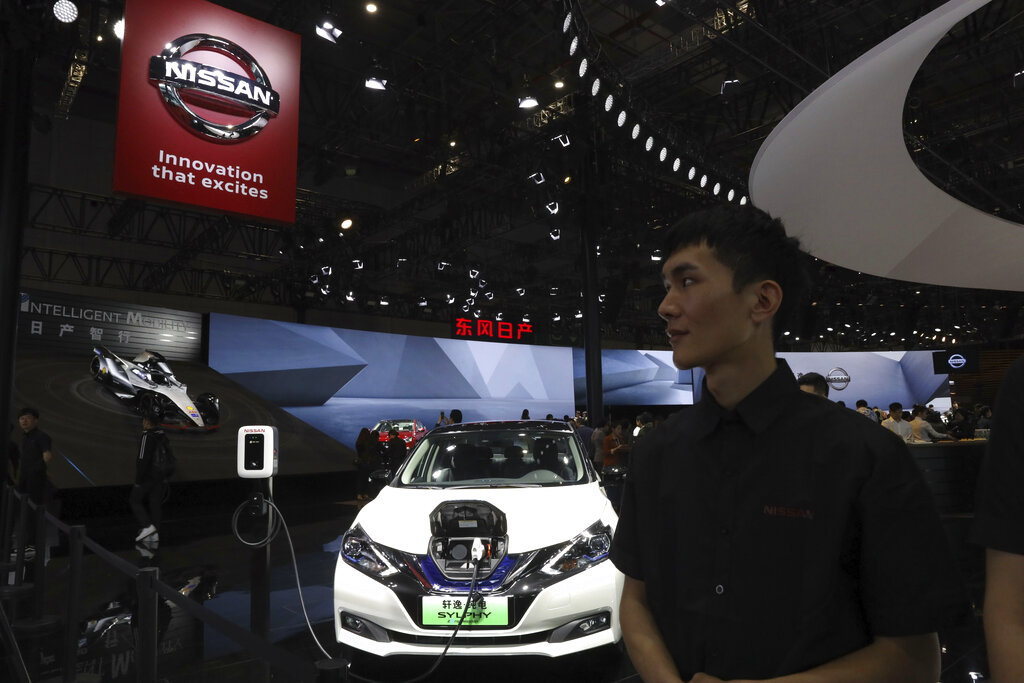 The Sylphy Zero Emission, an all-electric model designed for China is displayed at the Nissan booth during the Auto Shanghai 2019 show in Shanghai on Tuesday, April 16, 2019. (AP Photo/Ng Han Guan)