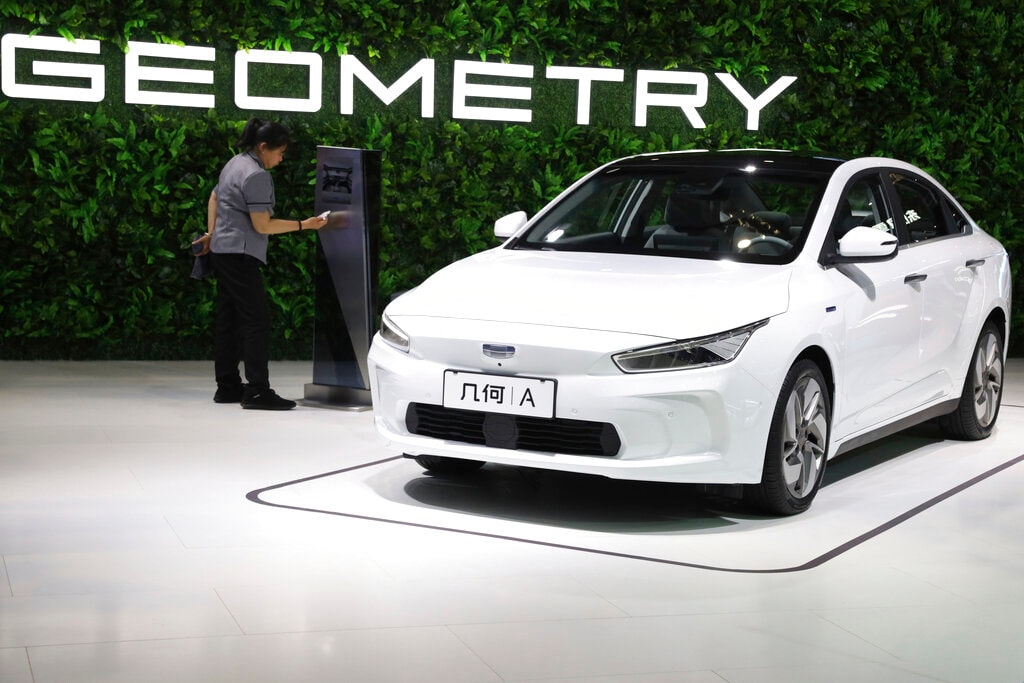 Chinese automaker Geely Auto displays a sedan from its new electric brand Geometry during the Auto Shanghai 2019 show in Shanghai Tuesday, April 16, 2019. (AP Photo/Ng Han Guan)