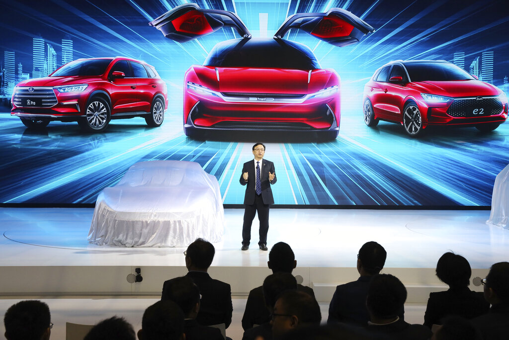 Wang Chuanfu, chairman and president of BYD Auto, the biggest global electric brand by sales volume, prepares to show the latest cars during the Auto Shanghai 2019 show in Shanghai Tuesday, April 16, 2019. (AP Photo/Ng Han Guan)