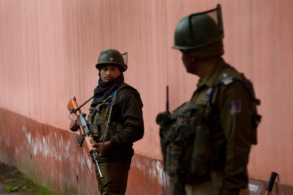 Paramilitary soldiers stand guard outside a polling station on the eve of the second phase of the general election in Srinagar, Jammu and Kashmir, Wednesday, April 17, 2019. (AP Photo/Dar Yasin)