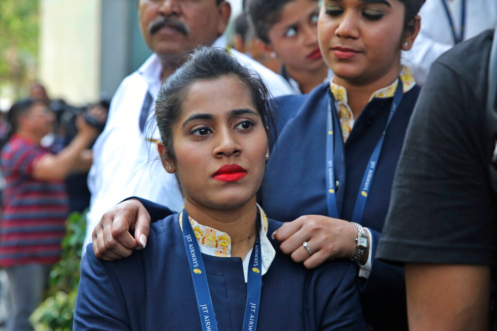 Employees of Jet Airways gather to demand clarification on unpaid salaries at the company headquarters in Mumbai, India Thursday, April 18, 2019. (AP Photo/Rafiq Maqbool)