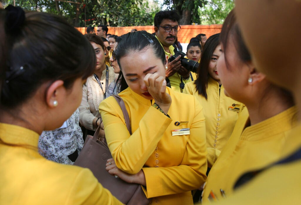 An employee of Jet Airways cries as she joins colleagues in a gathering to appeal to the government to save their company, in New Delhi, India, Thursday, April 18, 2019. (AP Photo/Manish Swarup)