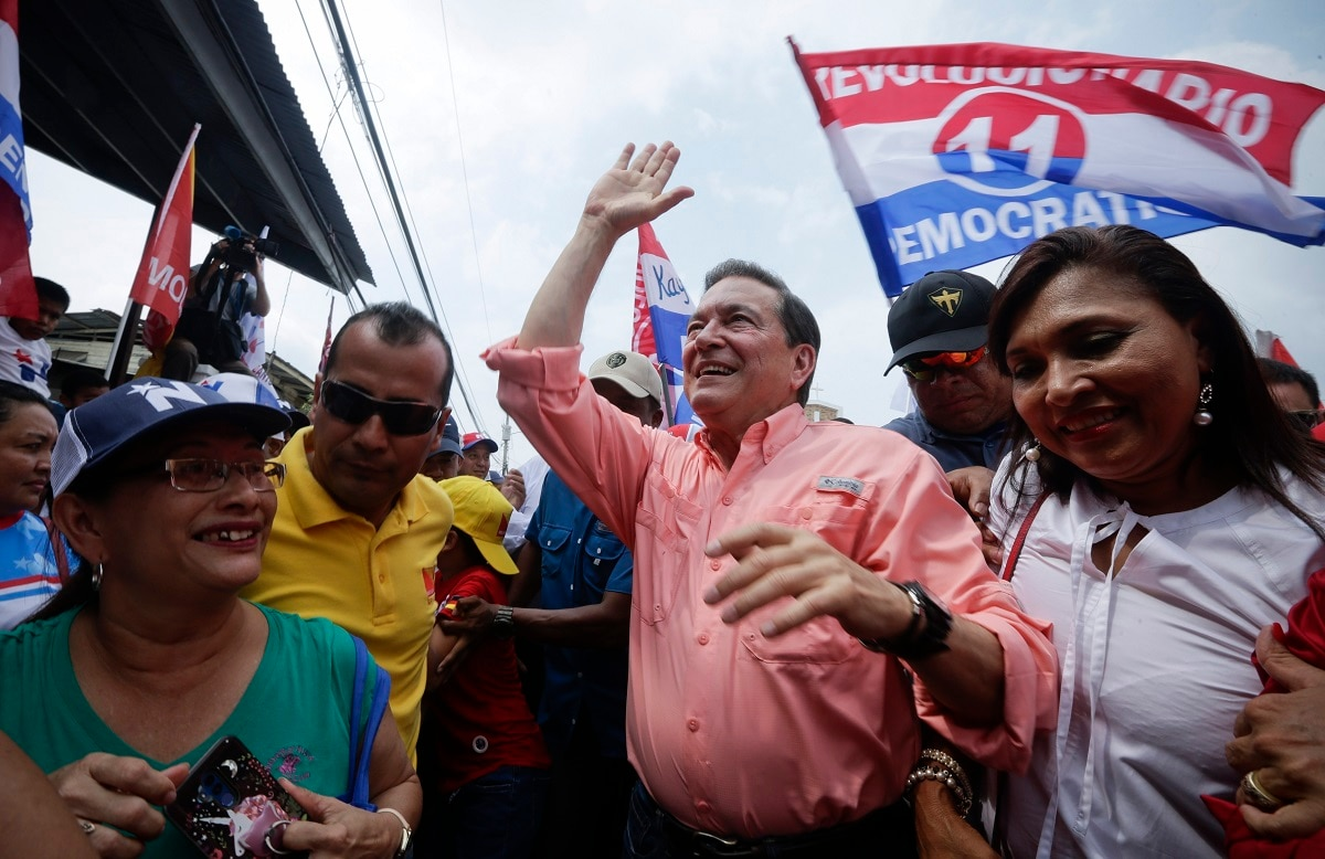 Presidential candidate Laurentino Cortizo, centre, of the Democratic Revolutionary Party (PRD), waves to supporters during a campaign rally in Arraijan, Panama. Panama will hold general elections on May 5. (AP Photo/Arnulfo Franco)