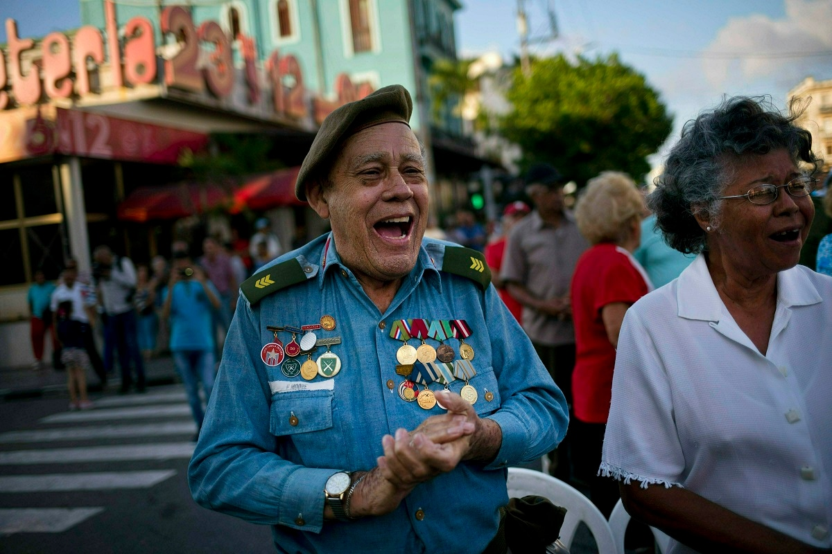 Edwin Moore, a veteran of the US Bay of Pigs invasion, sings during an event commemorating the 58th anniversary of Fidel Castro's declaration that his revolution in the 1950s was a socialist one, in Havana, Cuba. Reaction to news that the Trump administration plans to tighten sanctions against Cuba prompted worry, defiance and warnings on Tuesday, with Bay of Pigs veterans dismissing US pressure. (AP Photo/Ramon Espinosa)