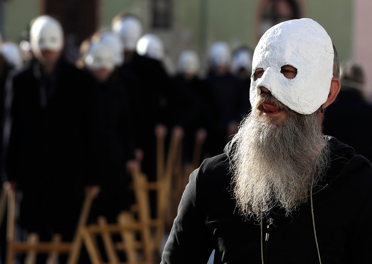 Participants dressed in black, wearing masks, beating drums and pushing small carts that make a synchronized and loud sound take part in an Easter procession through the streets of Ceske Budejovice. (AP Photo/Petr David Josek)