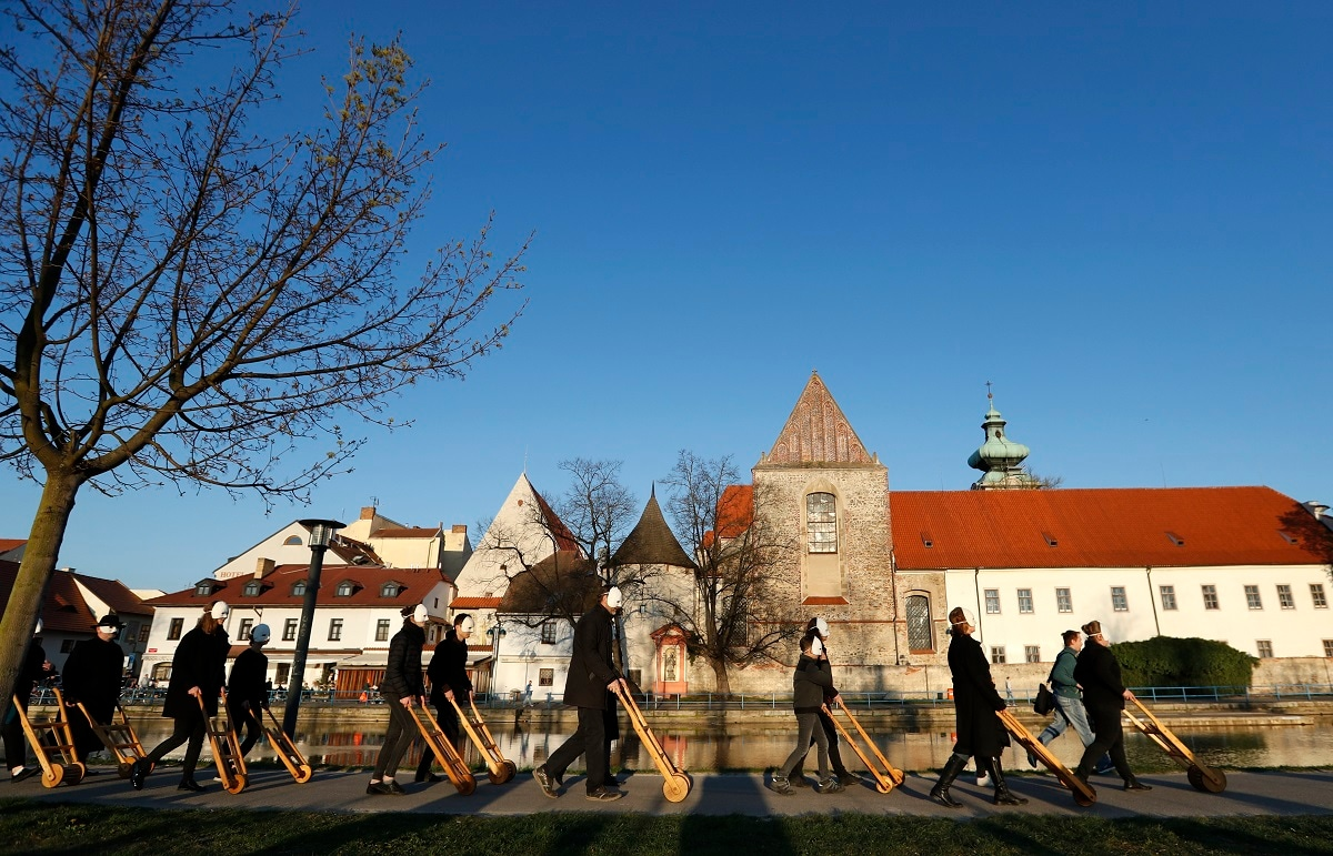 Participants dressed in black, wearing masks, beating drums and pushing small carts that make a synchronized and loud sound take part in an Easter procession through the streets of Ceske Budejovice, Czech Republic. (AP Photo/Petr David Josek)