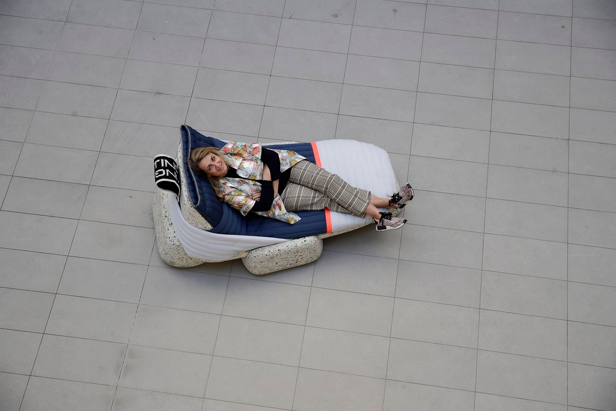 Designer Patricia Urquiola relaxes sitting on her creation 'Wasting Time Daybed' made from upcycled plastic for the