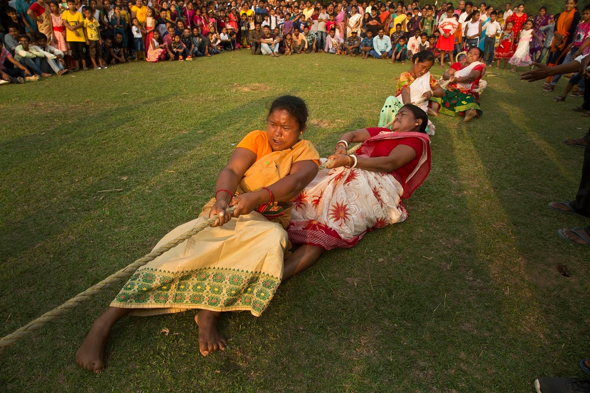 Women participate in a tug-of-war during Suwori Tribal festival in Boko, west of Gauhati, India. (AP Photo/Anupam Nath, File)