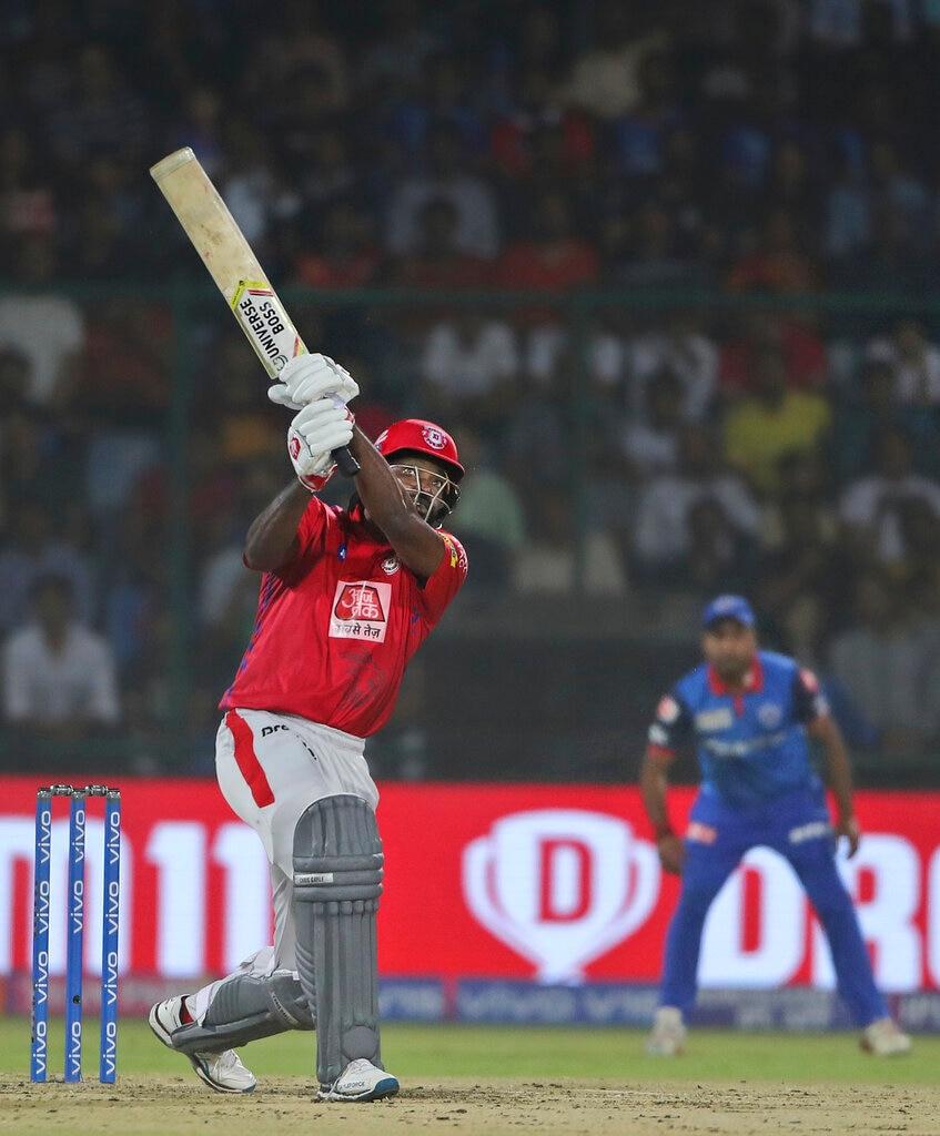 Kings XI Punjab batsman Chris Gayle plays a shot during VIVO IPL cricket T20 match against Delhi Capitals in New Delhi, India, Saturday, April 20, 2019. (AP Photo/Altaf Qadri)