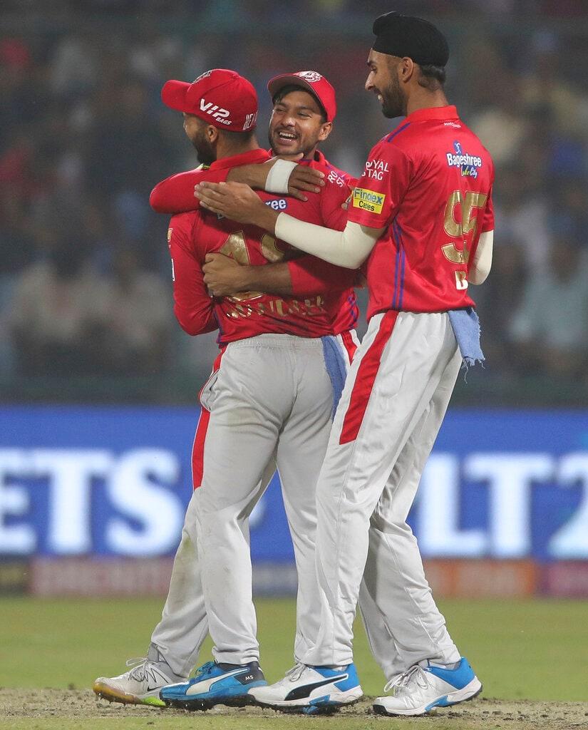 Kings XI Punjab players celebrate the dismissal of Delhi Capitals batsman Prithvi Shaw during VIVO IPL cricket T20 match in New Delhi, India, Saturday, April 20, 2019. (AP Photo/Altaf Qadri)