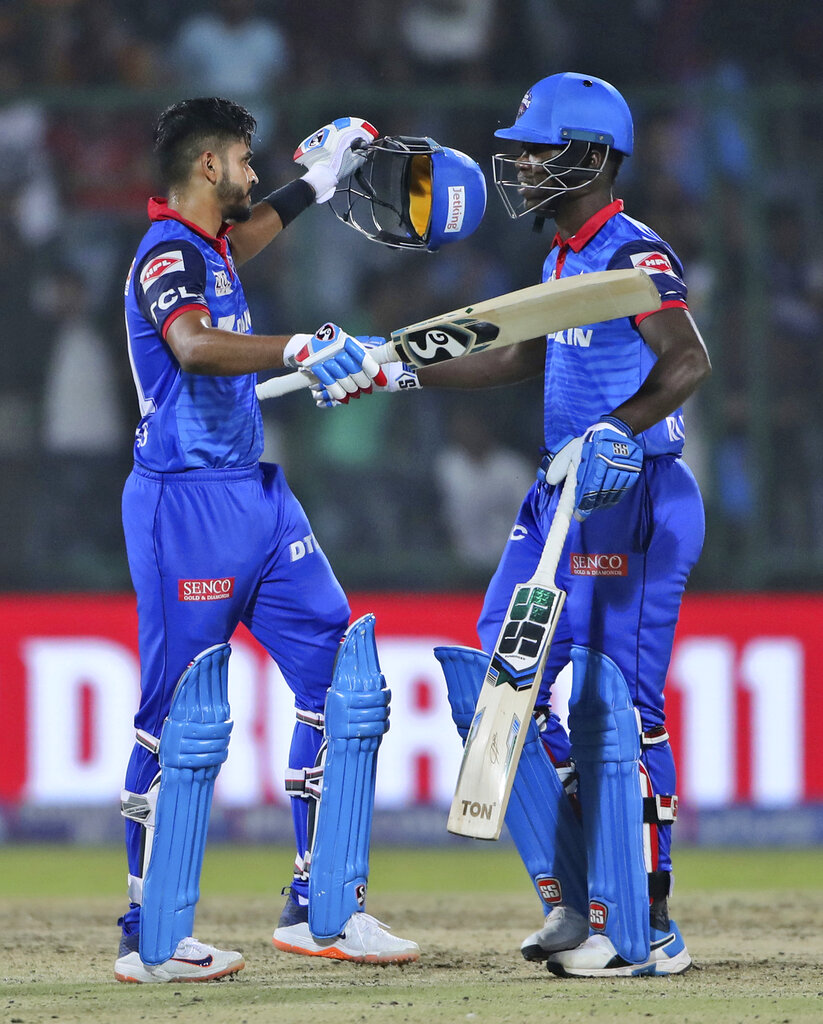 Delhi Capitals captain Shreyas Iyer, left, embraces his teammate Sherfane Rutherford after scoring winning runs during VIVO IPL cricket T20 match against Kings XI Punjab in New Delhi, India, Saturday, April 20, 2019. (AP Photo/Altaf Qadri)