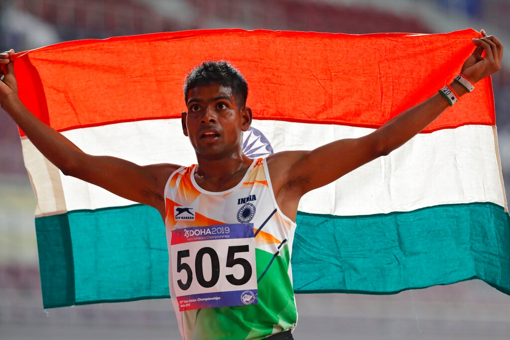 Gavit Murali Kumar celebrates after winning a bronze medal in the men's 10000m final at the 23rd Asian Athletics Championships in Doha, Qatar, Sunday, April 21, 2019. (AP Photo/Vincent Thian)