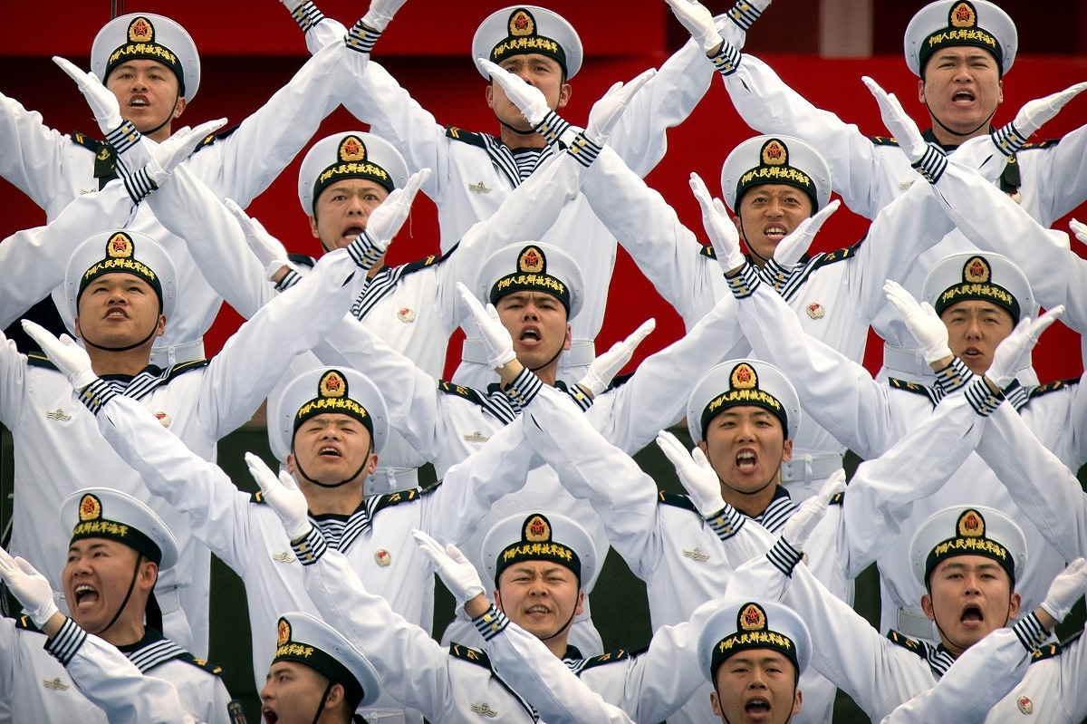 Chinese navy chorus performs during a concert featuring Chinese and foreign military bands in Qingdao. (AP Photo/Mark Schiefelbein, File)