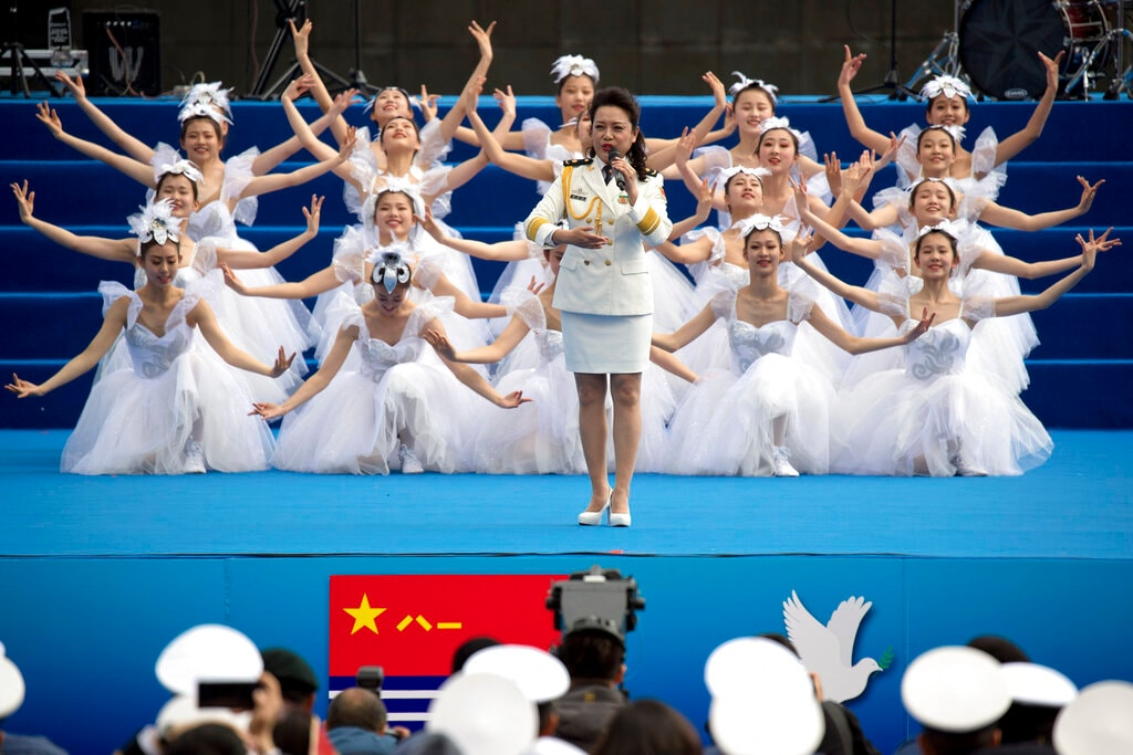 A Chinese navy singer performs during a concert featuring Chinese and foreign military bands in Qingdao, Monday, April 22, 2019. (AP Photo/Mark Schiefelbein)