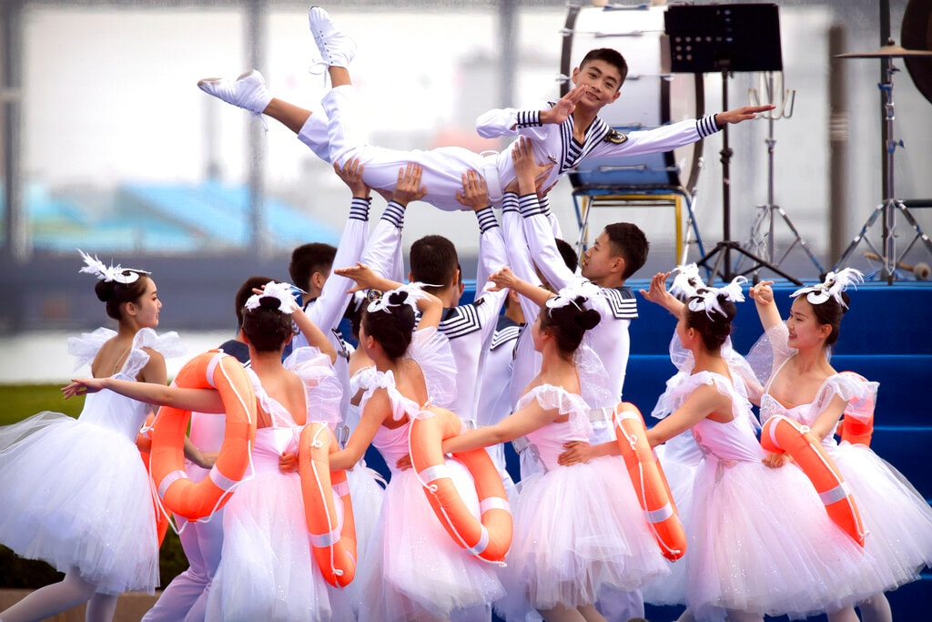 A Chinese military dance troupe performs during a concert featuring Chinese and foreign military bands in Qingdao, Monday, April 22, 2019. (AP Photo/Mark Schiefelbein)