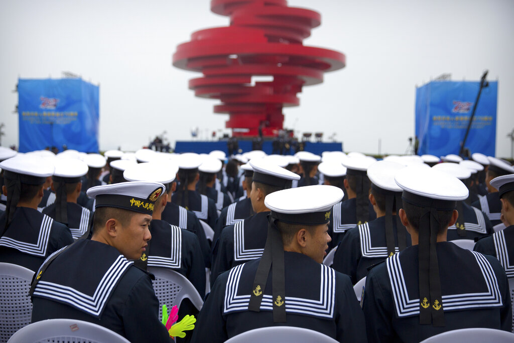 Chinese sailors sit during a concert featuring Chinese and foreign military bands in Qingdao, Monday, April 22, 2019. (AP Photo/Mark Schiefelbein)