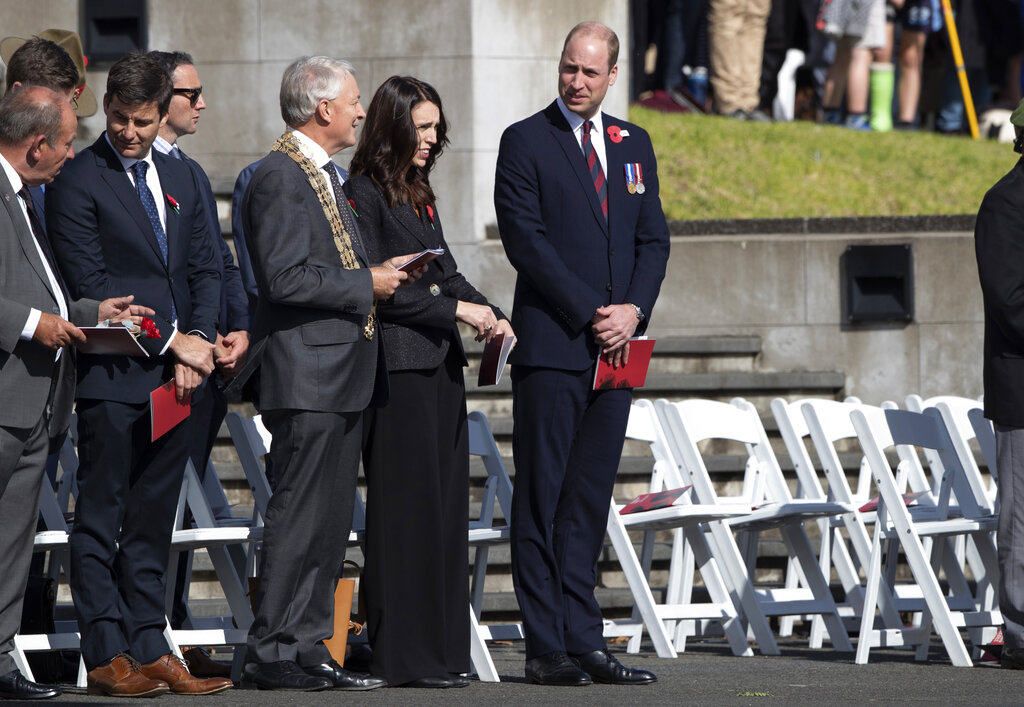 New Zealand Prime Minister Jacinda Ardern, centre left, and Britain's Prince William arrive to lay a wreath during an Anzac Day service in Auckland, New Zealand, Thursday, April 25, 2019. (Brett Phibbs/SNPA via AP)