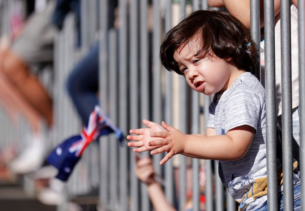 Two-year-old Sabastian Nunez claps his hands as he watches a march celebrating ANZAC Day, a national day of remembrance in Australia and New Zealand, in Sydney, Australia, Thursday, April 25, 2019. (AP Photo/Rick Rycroft)