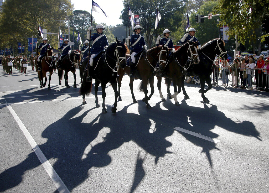 Riders participate in a march celebrating ANZAC Day, a national day of remembrance in Australia and New Zealand, in Sydney, Australia, Thursday, April 25, 2019. (AP Photo/Rick Rycroft)
