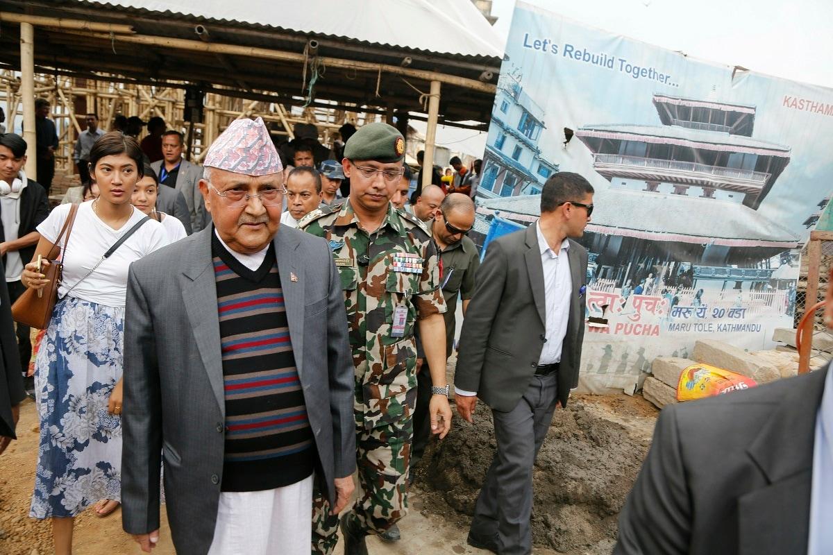 Nepal Prime Minister Khadga Prasad Oli, front left, inspects the reconstruction of the Kasthamandap temple. (AP Photo/Niranjan Shrestha)