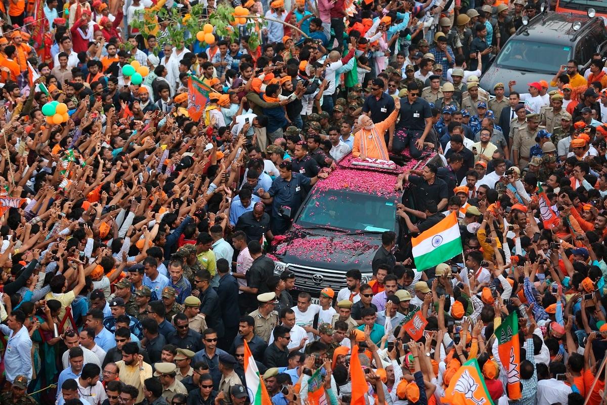 Prime Minister Narendra Modi waves to the crowd during a roadshow in Varanasi. (AP Photo/Rajesh Kumar Singh)