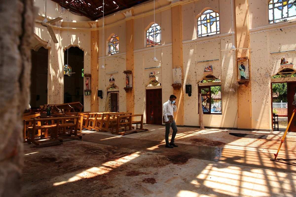 A surveyor walks inside the damaged St. Sebastian's Church where a suicide bomber blew himself up on Sunday Easter in Negombo, north of Colombo, Sri Lanka. (AP Photo/Manish Swarup)