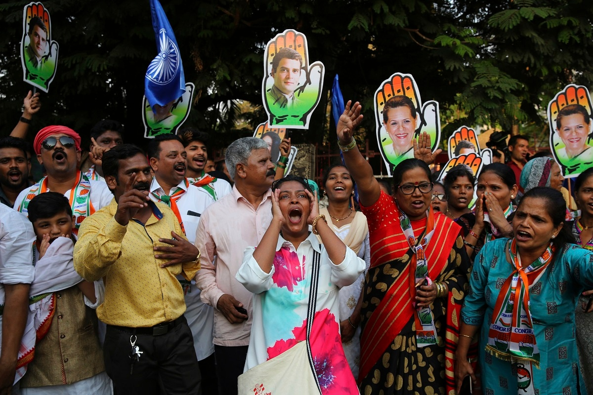 Supporters of Congress party shout slogans during an election rally Mumbai. (AP Photo/Rafiq Maqbool)