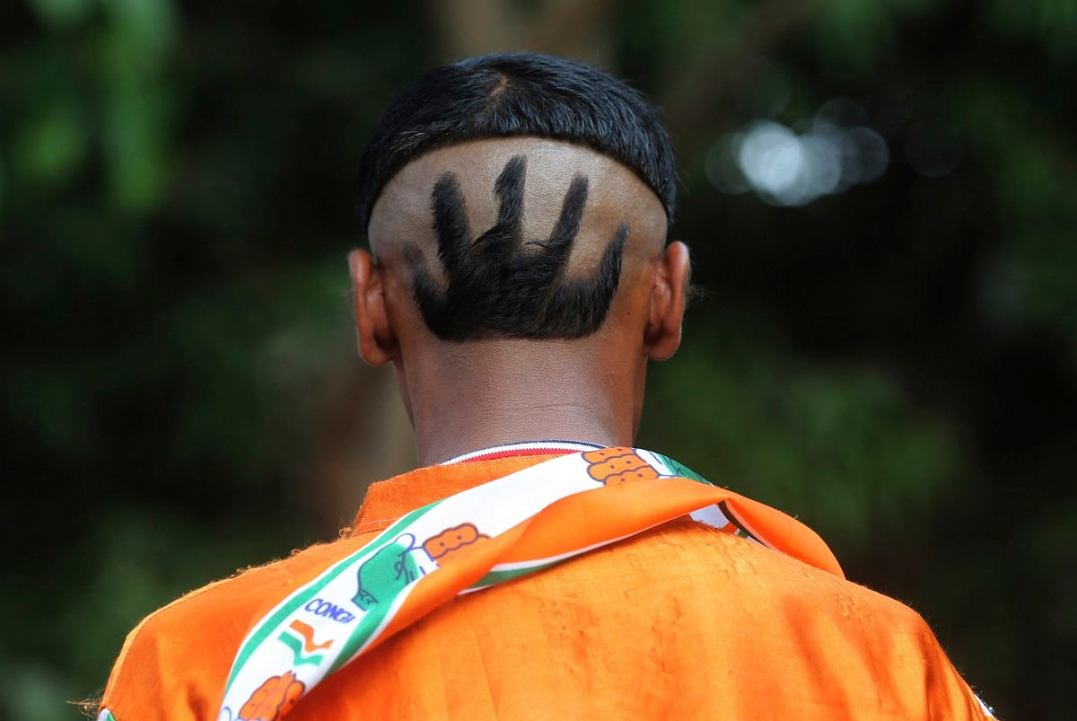 A supporter of India's Congress party displays a haircut with his party symbol during an election rally Mumbai. (AP Photo/Rafiq Maqbool)