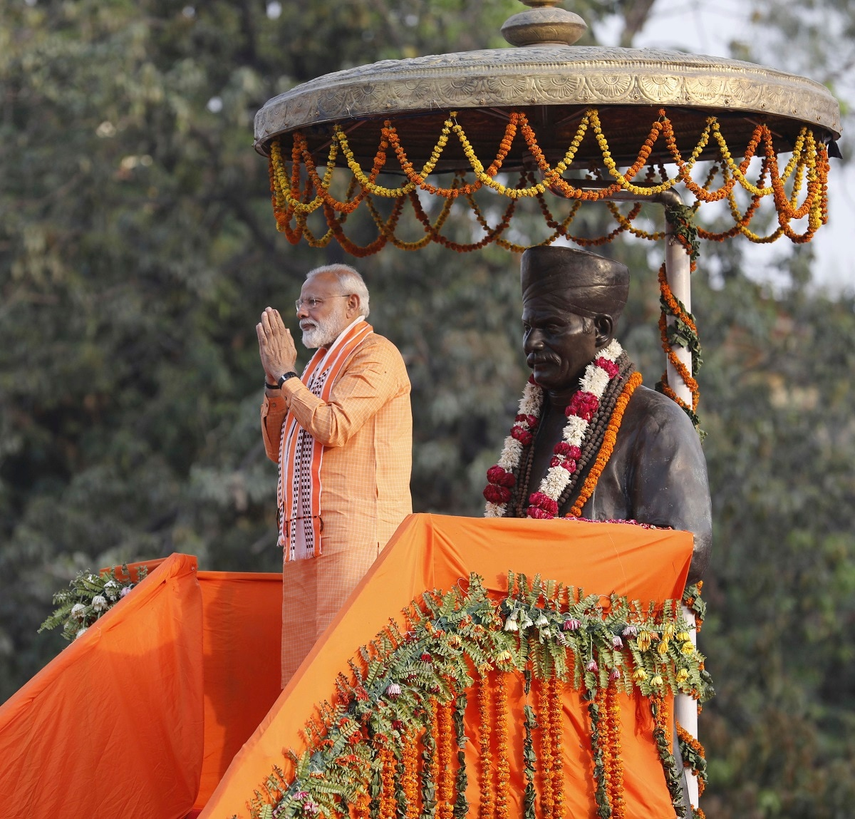 Prime Minister Narendra Modi greets the crowd as he stands in front of a statue of freedom fighter Madan Mohan Malviya at Banaras Hindu University in Varanasi. (AP Photo/Rajesh Kumar Singh)