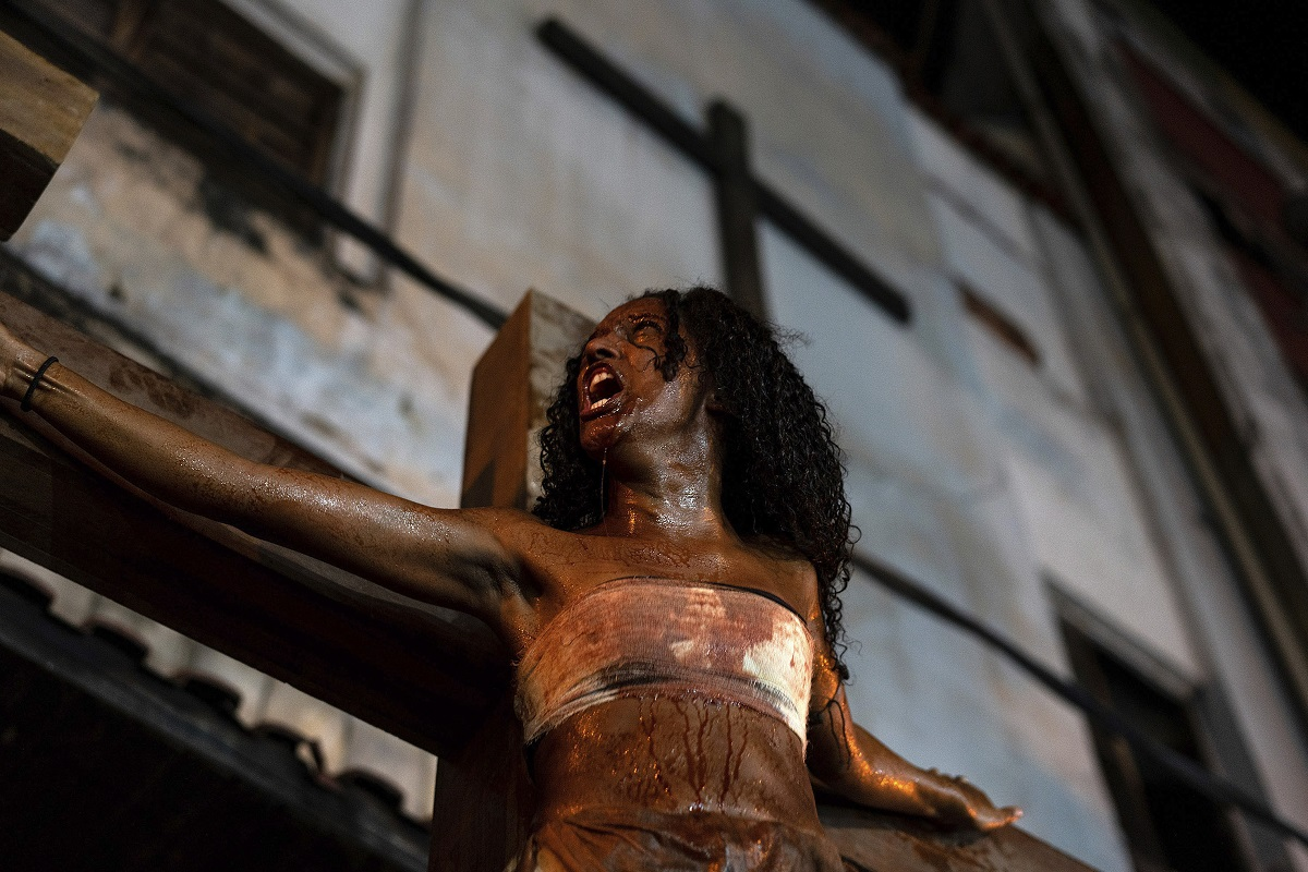 A woman plays one of the two thieves crucified with Jesus during the reenactment of the Passion of Christ on Good Friday during Holy Week at the Rocinha slum in Rio de Janeiro, Brazil. Residents who organized acted and directed the play have translated it to reflect the scenery and realities around them. They say the themes of violence, persecution and injustice resonate with their lives. (AP Photo/C.H. Gardiner)