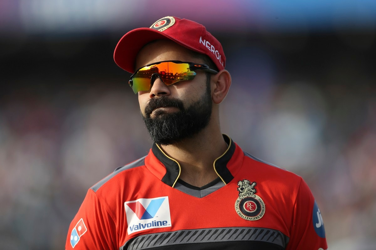 Royal Challengers Bangalore captain Virat Kohli reacts after Delhi Capitals batsman Sherfane Rutherford hits a six. (AP Photo/Altaf Qadri)
