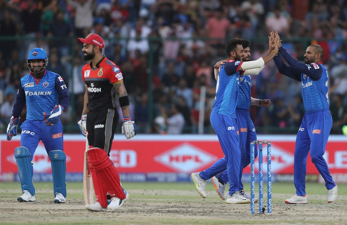 Delhi Capitals players celebrate the wicket of Royal Challengers Bangalore captain Virat Kohli. (AP Photo/Altaf Qadri)