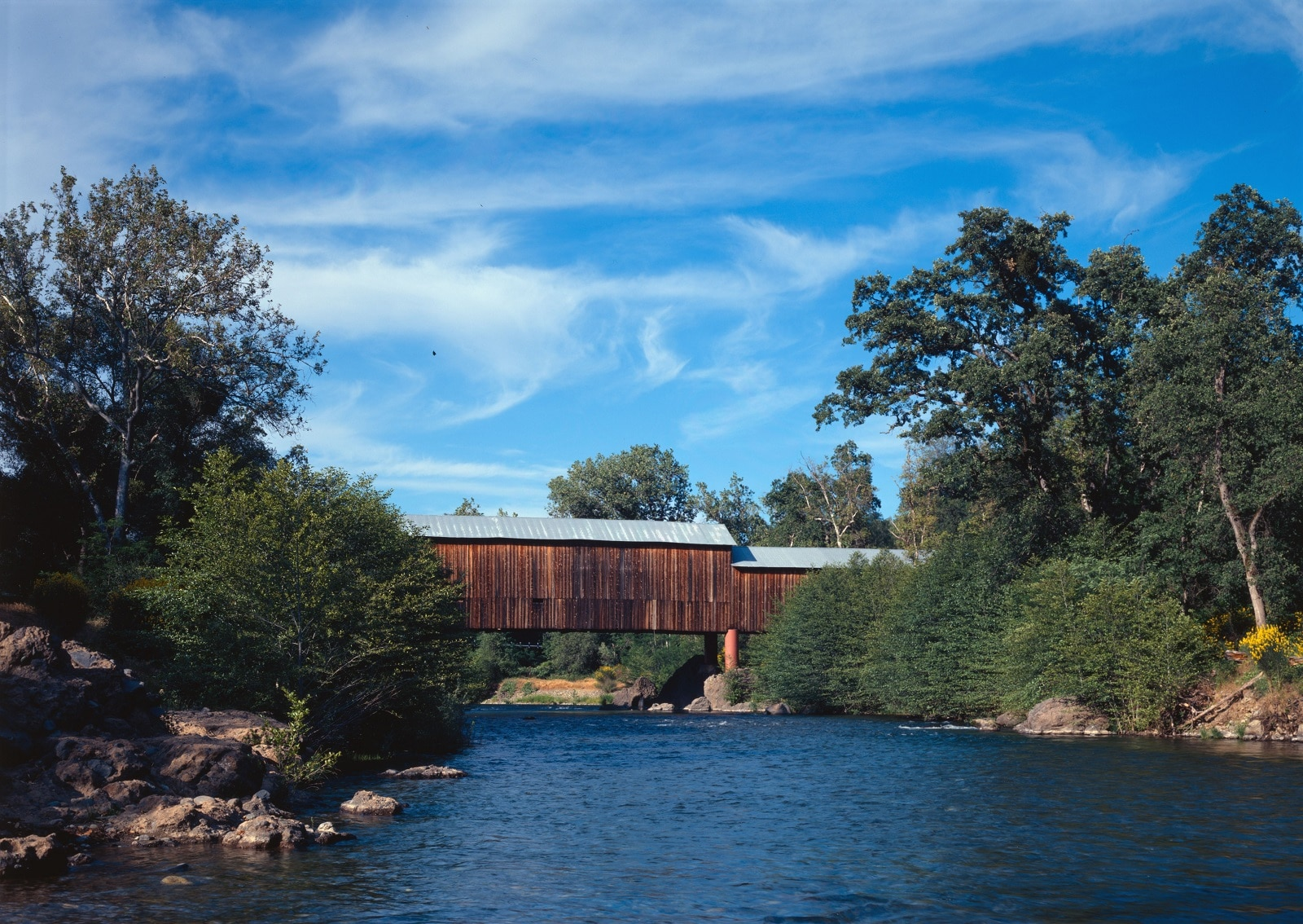 The Honey Run Covered Bridge — Butte County, California: The historic bridge was built in 1886 and was the only covered bridge in the US with three unequal sections and was listed on the National Register of Historic Places. However, it was burned down in the camp fire that devastated Northern California in 2018.