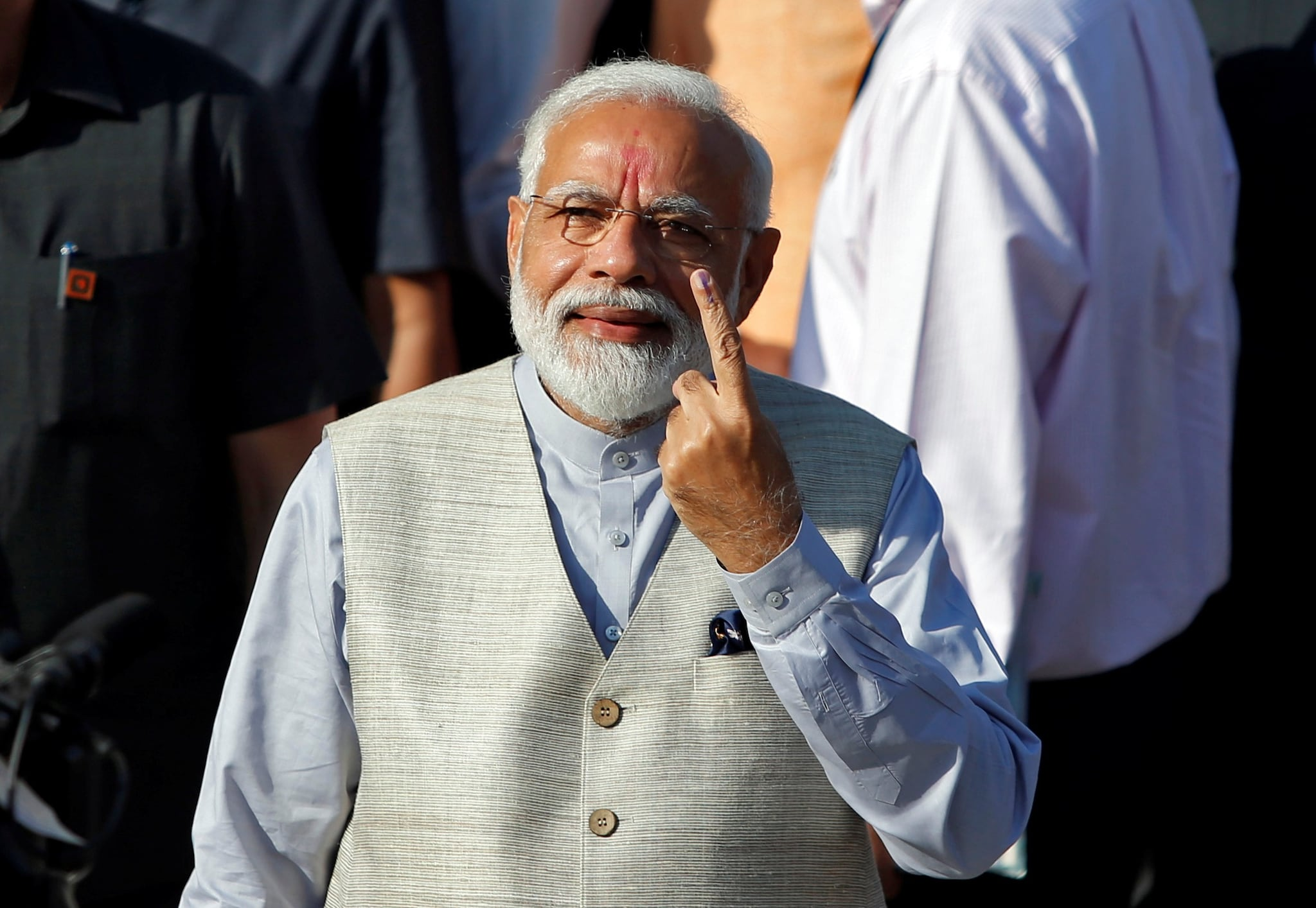 Prime Minister Narendra Modi shows his ink-marked finger after casting his vote outside a polling station during the third phase of general election in Ahmedabad, April 23, 2019. REUTERS/Amit Dave