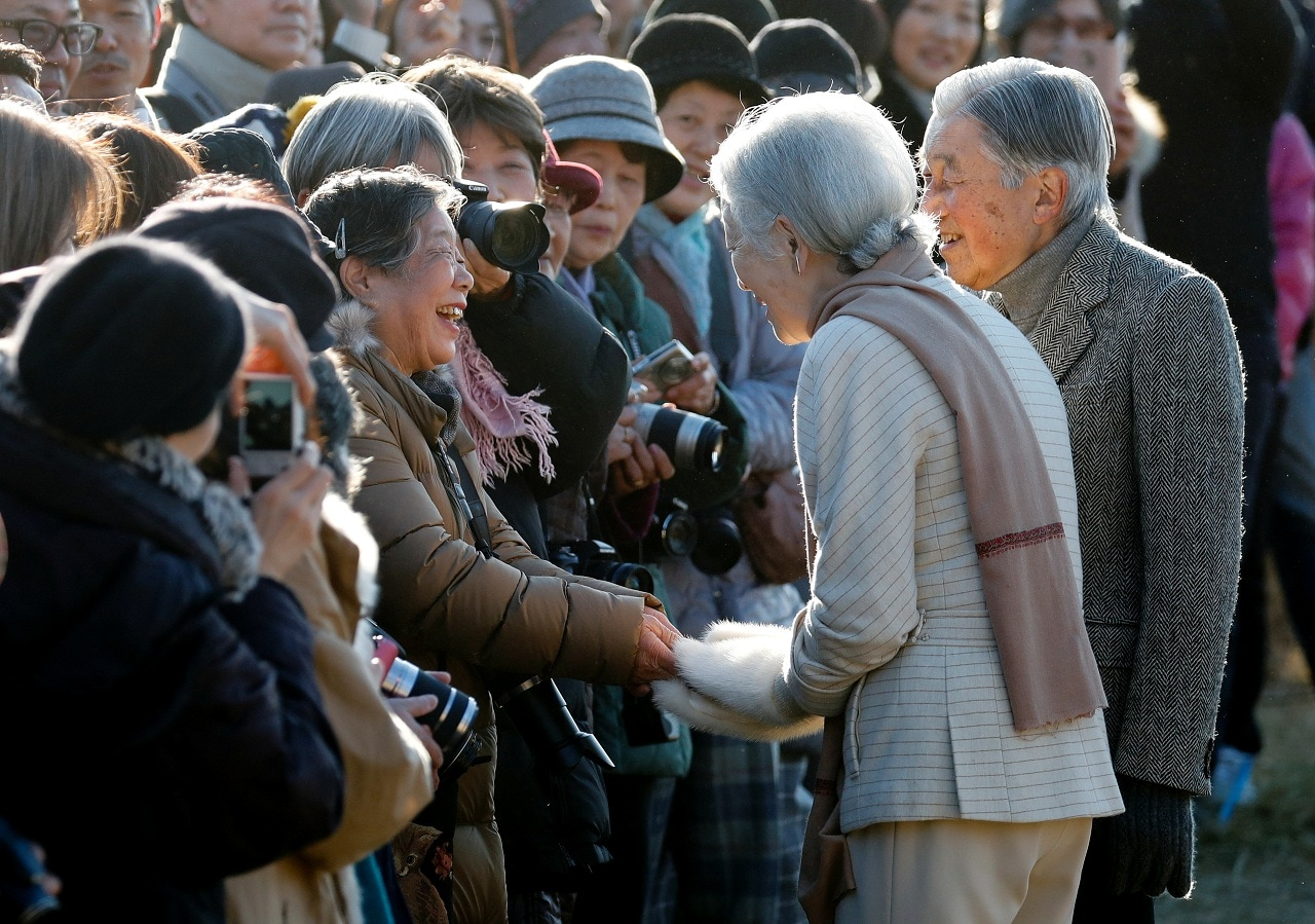 Royal aficionado Fumiko Shirataki, 78, shakes hands with Japan's Empress Michiko near an imperial villa where Japan's Emperor Akihito and Empress Michiko are staying for their recuperation in Hayama town, south of Tokyo, Japan, January 21, 2019. (Reuters)