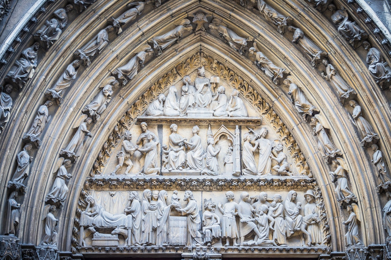 A facade over a door outside the Notre-Dame Cathedral, Paris.