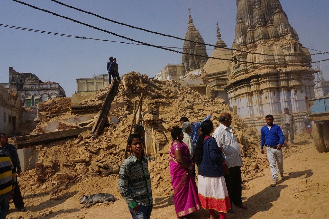 People look at the debris after Uttar Pradesh government demolished houses and temples to make way for the Rs 600 crore Kashi Vishwanath Mandir Vistarikaran-Saundarayakaran Yojana (Kashi Vishwanath Temple Extension and Beautification Plan).
