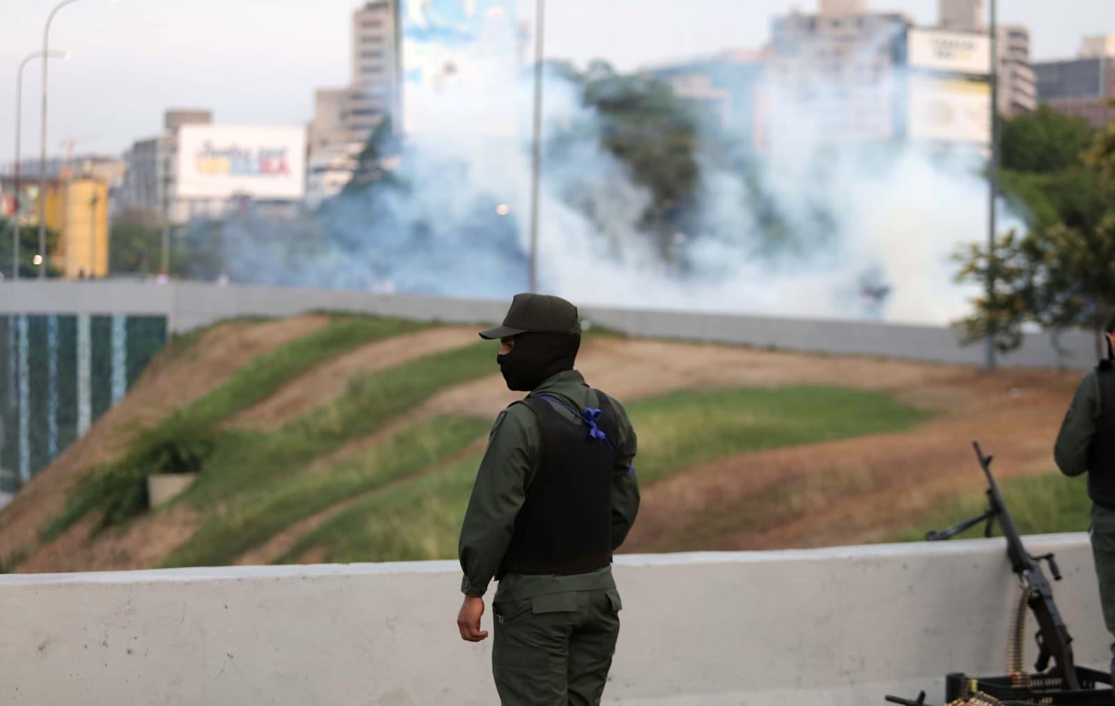 Tear gas floats in the air near the Generalisimo Francisco de Miranda Airbase