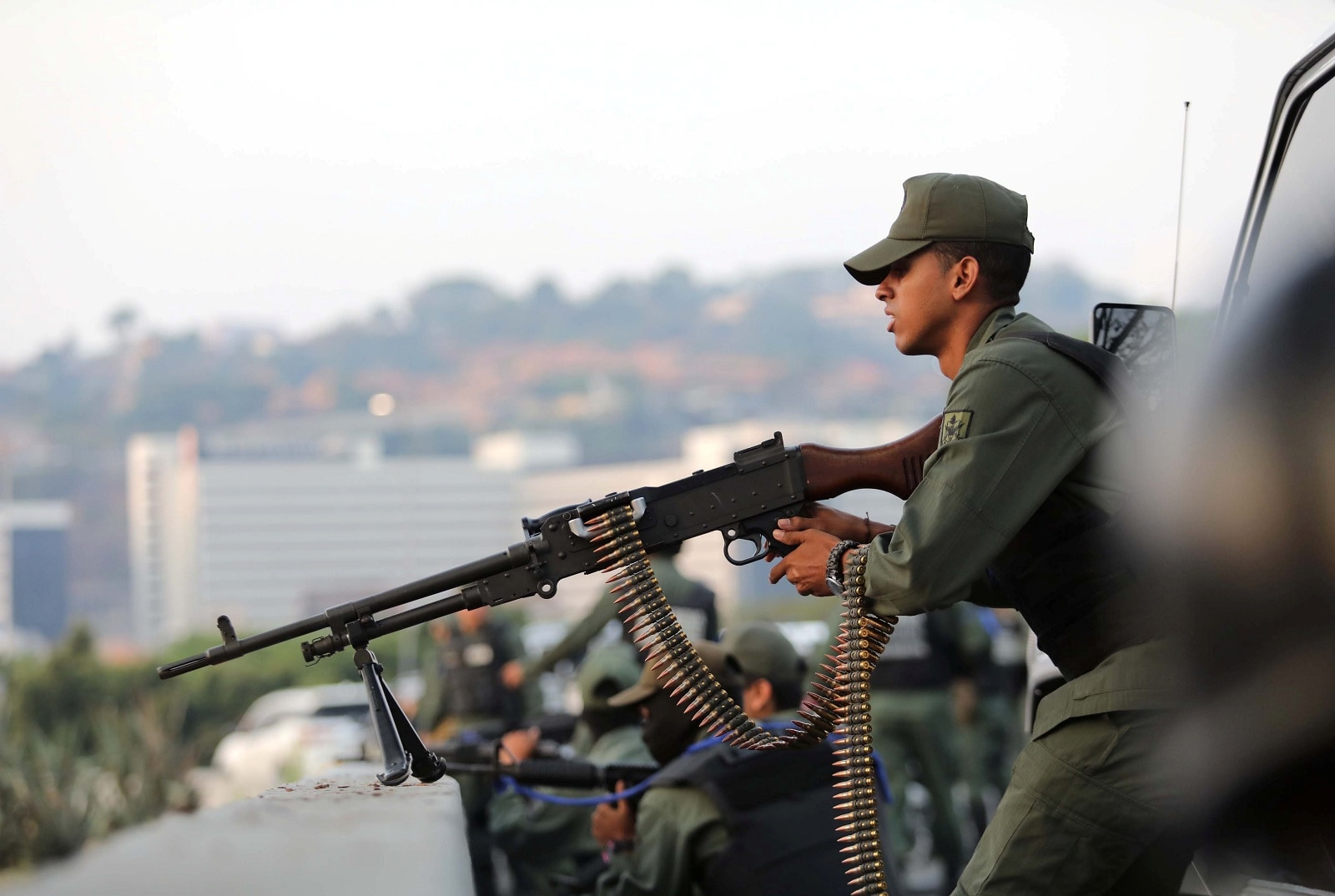 A military member aims a weapon near the Generalisimo Francisco de Miranda Airbase