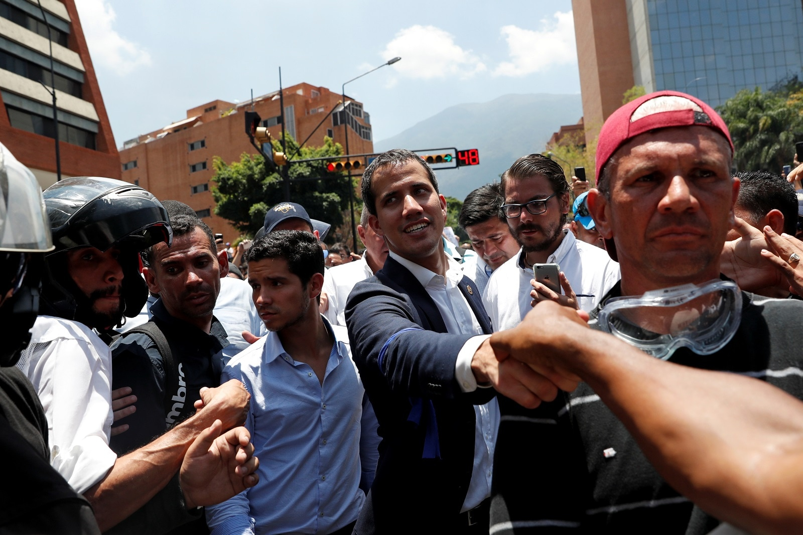 Venezuelan opposition leader Juan Guaido, who many nations have recognised as the country's rightful interim ruler, walks with supporters in Caracas, Venezuela April 30, 2019. REUTERS/Carlos Garcia Rawlins